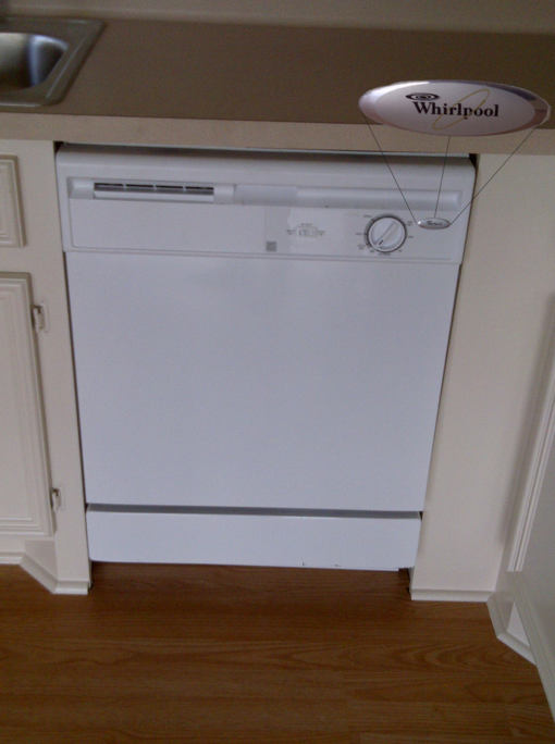This is a picture of the new Whirlpool Dishwasher that was installed in the house for sale at 106 Magnolia Lane, Conroe, Texas 77304