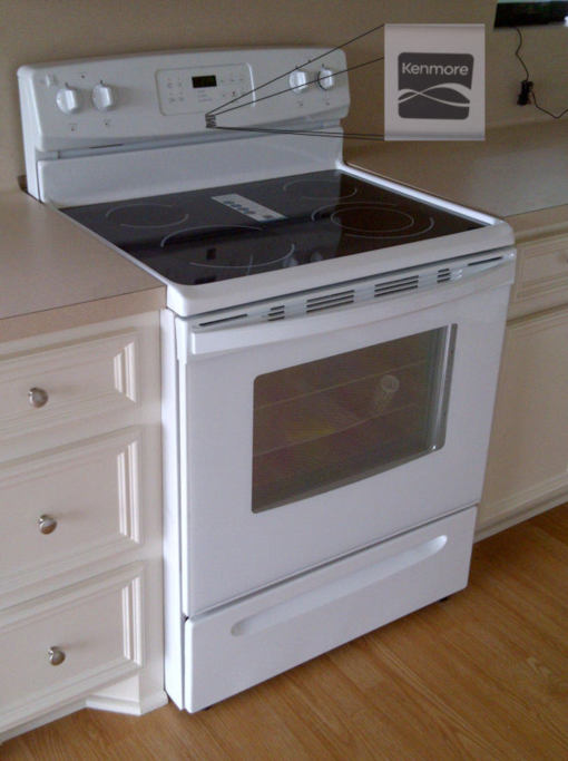 This is a picture of the new Kenmore stove/oven that was installed in the house for sale at 106 Magnolia Lane, Conroe, Texas 77304